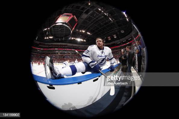 Matt Gilroy of the Tampa Bay Lightning stretches along the player bench prior to the game against the Florida Panthers on November 25 2011 at the...