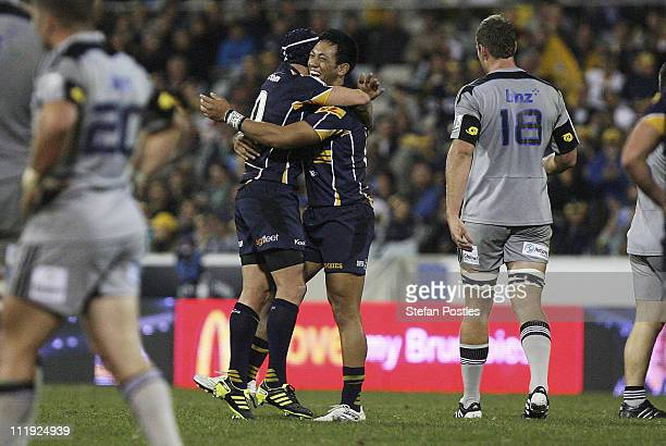 Matt Giteau and Christian Lealiifano of the Brumbies celebrate after winning the round eight Super Rugby match between the Brumbies and the...
