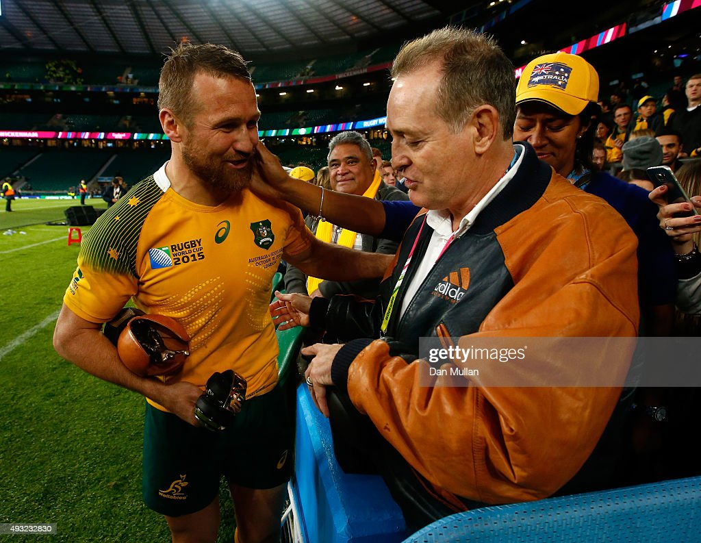 <a gi-track='captionPersonalityLinkClicked' href=/galleries/search?phrase=Matt+Giteau&family=editorial&specificpeople=206460 ng-click='$event.stopPropagation()'>Matt Giteau</a> of Australia celebrates with former Wallaby <a gi-track='captionPersonalityLinkClicked' href=/galleries/search?phrase=David+Campese&family=editorial&specificpeople=228135 ng-click='$event.stopPropagation()'>David Campese</a> after the 2015 Rugby World Cup Quarter Final match between Australia and Scotland at Twickenham Stadium on October 18, 2015 in London, United Kingdom.