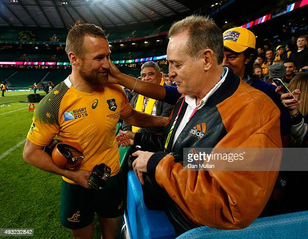 Matt Giteau of Australia celebrates with former Wallaby David Campese after the 2015 Rugby World Cup Quarter Final match between Australia and...