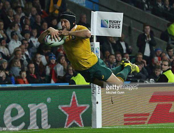 Matt Giteau of Australia dives over to score a try during the 2015 Rugby World Cup Pool A match between England and Australia at Twickenham Stadium...
