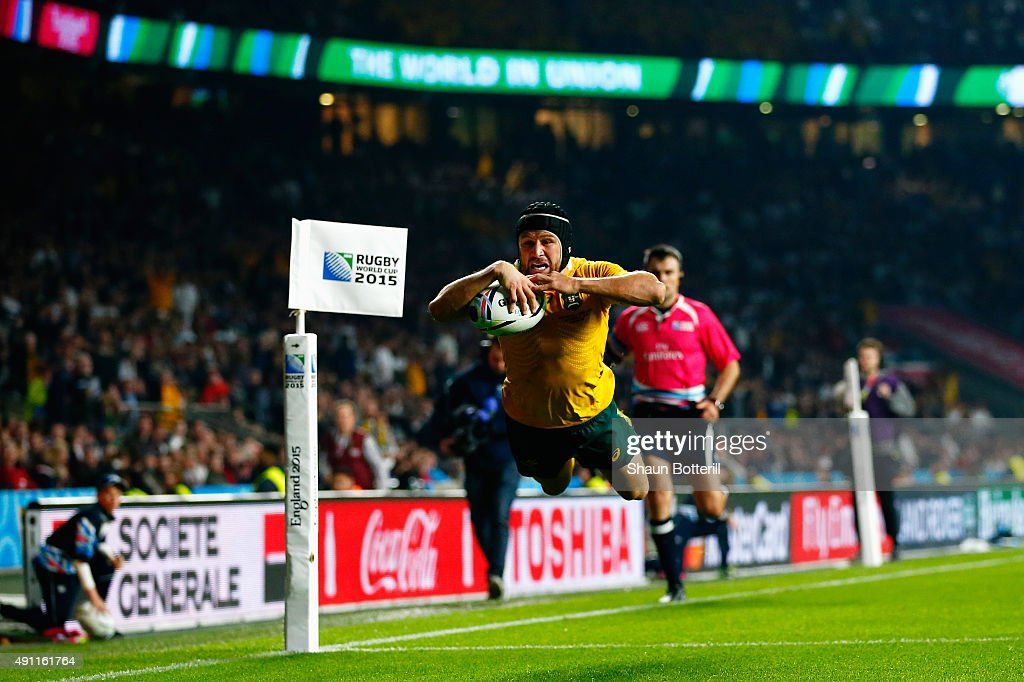 <a gi-track='captionPersonalityLinkClicked' href=/galleries/search?phrase=Matt+Giteau&family=editorial&specificpeople=206460 ng-click='$event.stopPropagation()'>Matt Giteau</a> of Australia goes over to score their third try during the 2015 Rugby World Cup Pool A match between England and Australia at Twickenham Stadium on October 3, 2015 in London, United Kingdom.