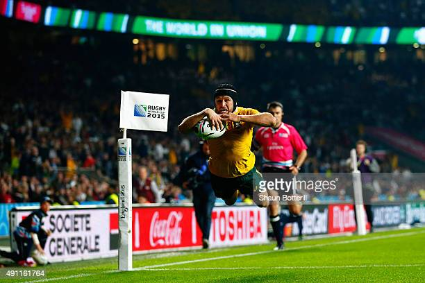 Matt Giteau of Australia goes over to score their third try during the 2015 Rugby World Cup Pool A match between England and Australia at Twickenham...