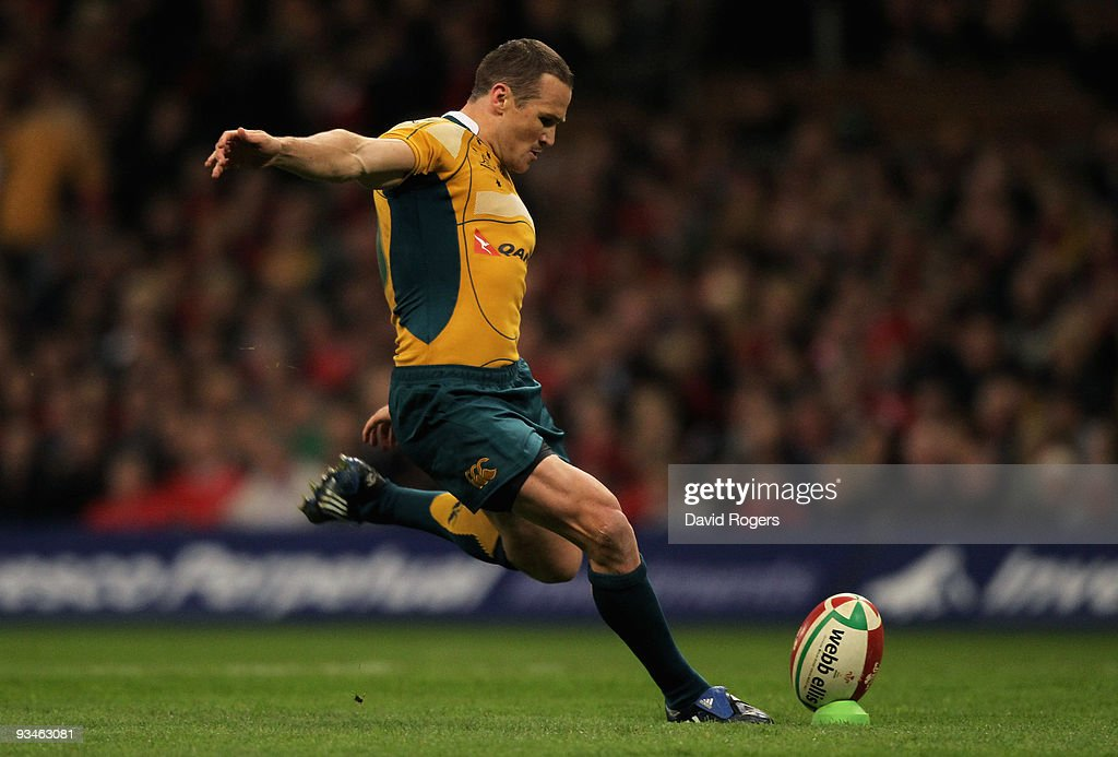 <a gi-track='captionPersonalityLinkClicked' href=/galleries/search?phrase=Matt+Giteau&family=editorial&specificpeople=206460 ng-click='$event.stopPropagation()'>Matt Giteau</a> of Australia kicks a conversion during the Invesco Perpetual Series match between Wales and Australia at the Millennium Stadium on November 28, 2009 in Cardiff, Wales.