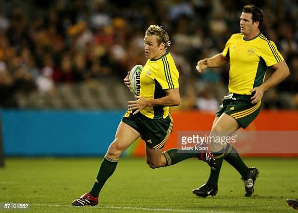 Matt Giteau of Australia scores a try during the rugby sevens match between Australia and Sri Lanka at the Telstra Dome on day one of the Melbourne...