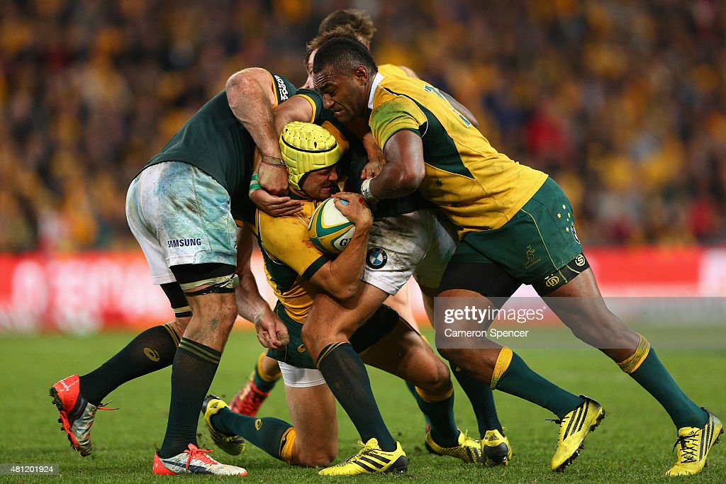 Matt Giteau of the Wallabies is tackled during The Rugby Championship match between the Australian Wallabies and the South Africa Springboks at Suncorp Stadium on July 18, 2015 in Brisbane, Australia.
