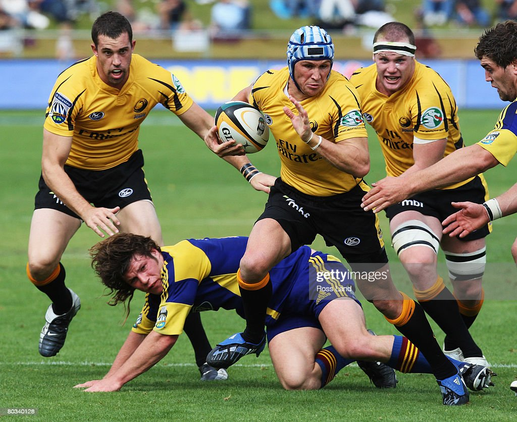 Matt Giteau of the Western Force busts through the Highlanders defence during the round six Super 14 match between the Highlanders and the Western...