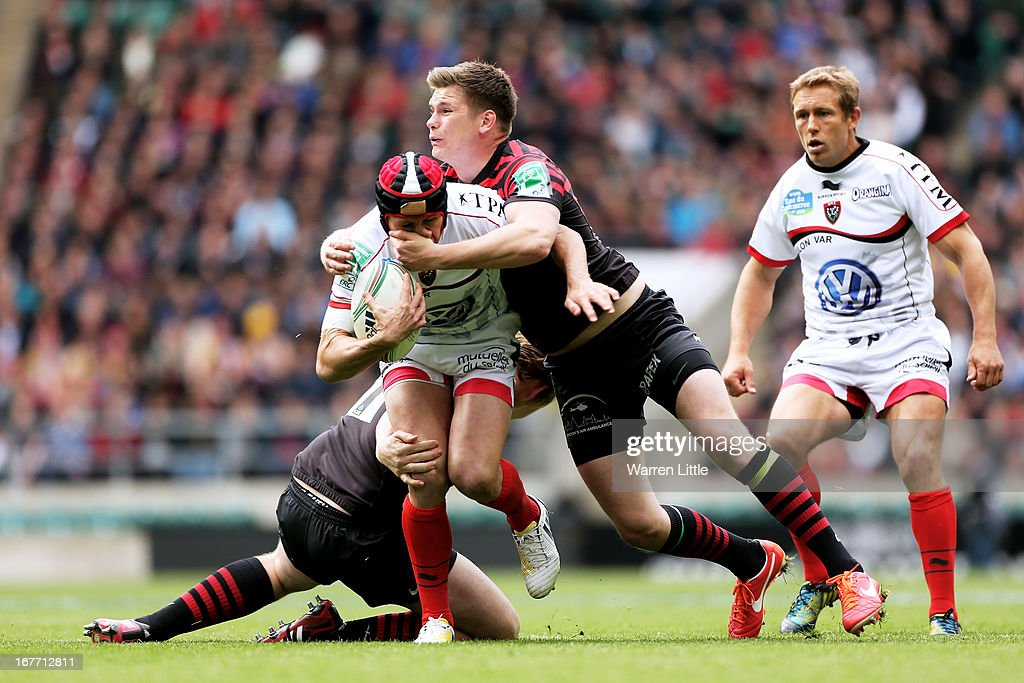 <a gi-track='captionPersonalityLinkClicked' href=/galleries/search?phrase=Matt+Giteau&family=editorial&specificpeople=206460 ng-click='$event.stopPropagation()'>Matt Giteau</a> of Toulon is hauled down by <a gi-track='captionPersonalityLinkClicked' href=/galleries/search?phrase=Owen+Farrell&family=editorial&specificpeople=4809668 ng-click='$event.stopPropagation()'>Owen Farrell</a> of Saracens during the Heineken Cup semi final between Saracens and Toulon at Twickenham Stadium on April 28, 2013 in London, United Kingdom.
