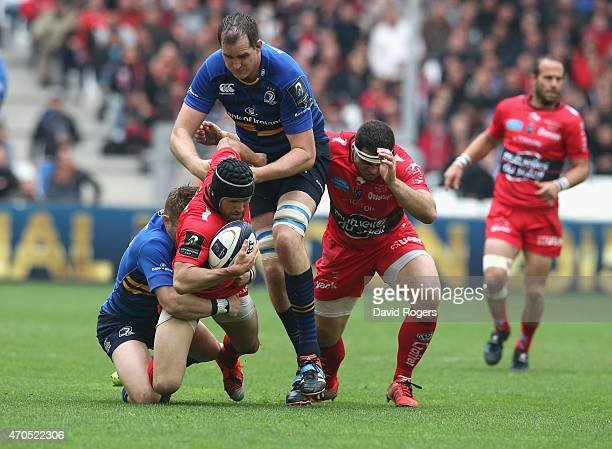 Matt Giteau of Toulon is tackled during the European Rugby Champions Cup semi final match between RC Toulon and Leinster at Stade Velodrome on April...