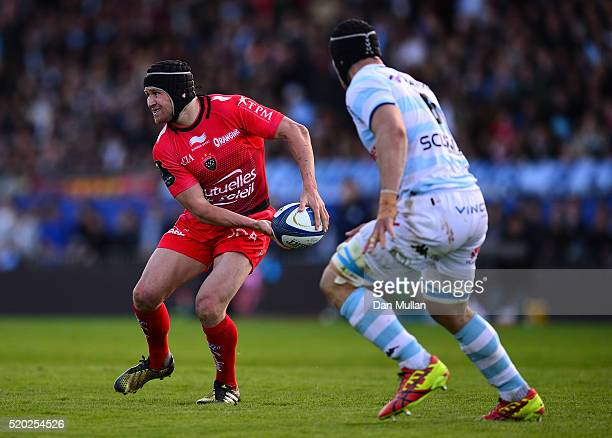 Matt Giteau of Toulon looks for a pass under pressure from Wenceslas Lauret of Racing 92 during the European Rugby Champions Cup Quarter Final...