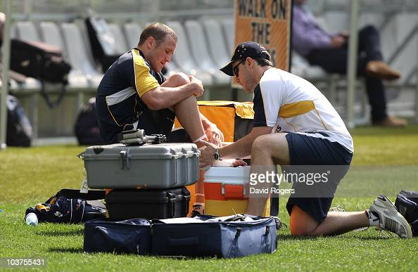 Matt Giteau the Wallaby centre receives attention to an injury to his right ankle during an Australian Wallabies training session held at the Moses...
