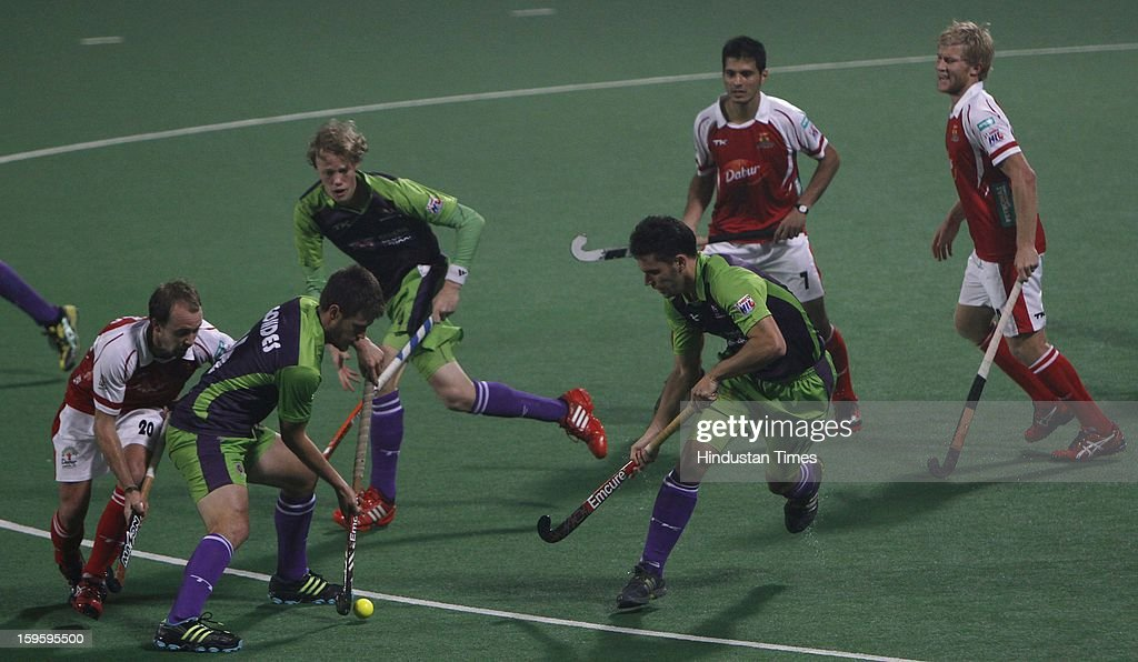 Matt Gohdes of Delhi Waveriders negotiates with Swann Mathew of Mumbai Magician during Hockey India League match at Major Dhyan Chand National Stadium on January 16, 2013 in New Delhi, India.