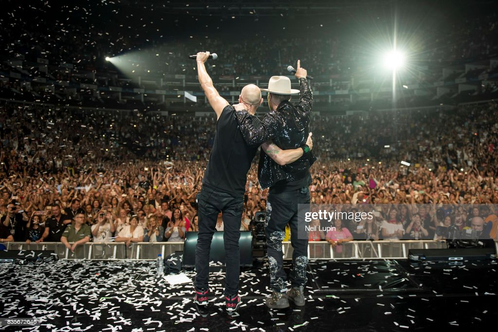 Matt Goss and Luke Goss of Bros perform at The O2 Arena on August 19, 2017 in London, England.