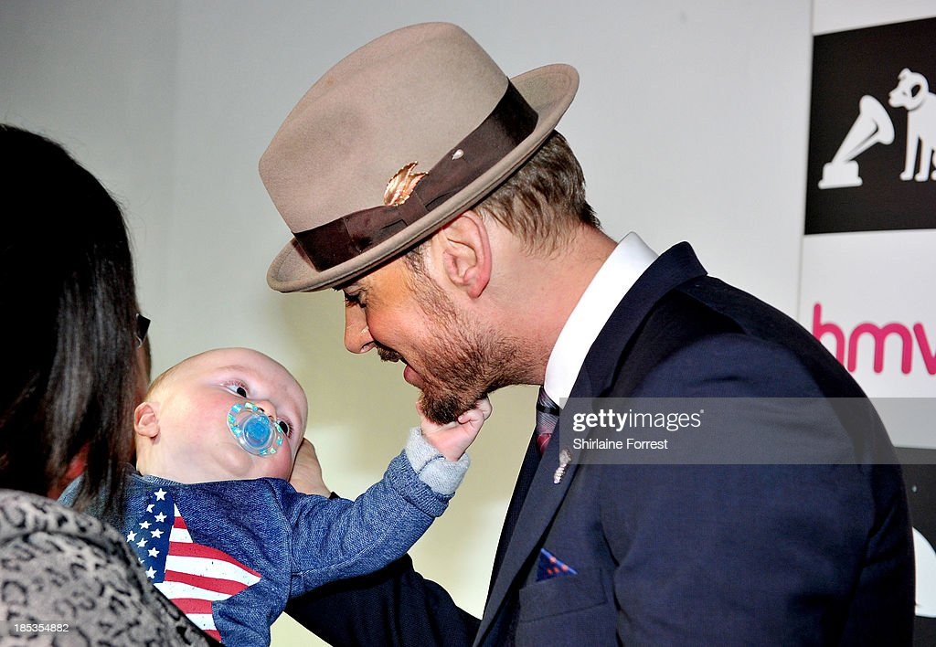 Matt Goss has his beard pulled by young fan Roman Cannon while meeting fans and signing copies of his new album 'Life You Imagine' at HMV Manchester on October 19, 2013 in Manchester, England.