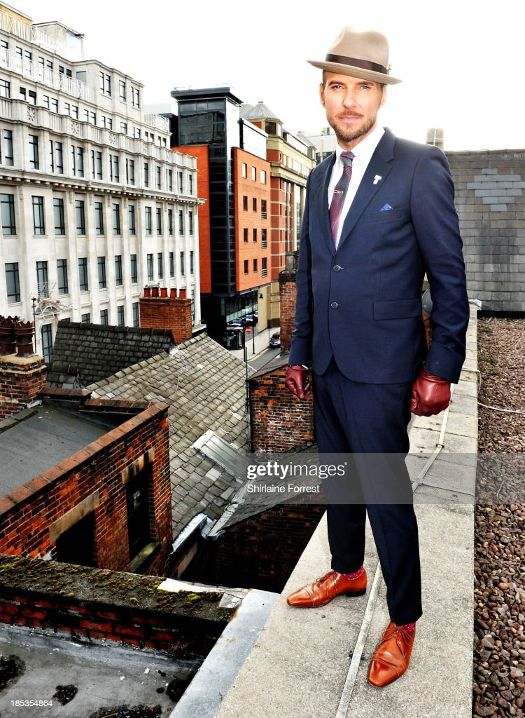 Matt Goss poses on the rooftop after meeting fans and signing copies of his new album 'Life You Imagine' at HMV Manchester on October 19, 2013 in Manchester, England.
