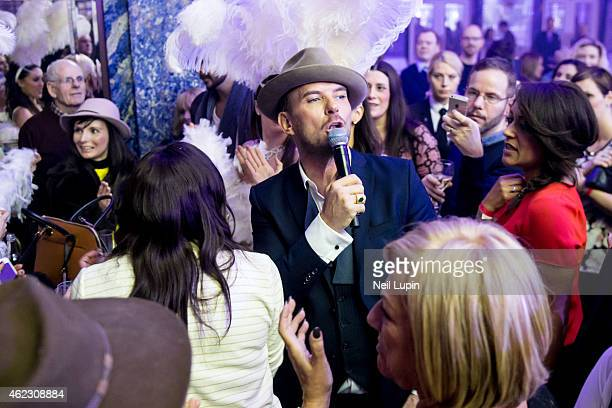 Matt Goss serenades journalist Amy Watts during a one off Emergency Show at The Dorchester Ballroom at the Dorchester Hotel on January 26 2015 in...