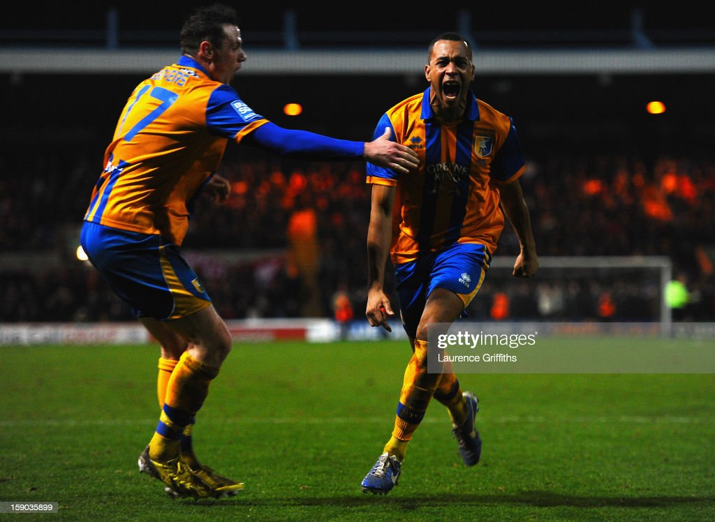 Matt Green of Mansfield Town celebrates his goal with Lee Beevers during the FA Cup with Budweiser Third Round match between Mansfield Town and Liverpool at One Call Stadium on January 6, 2013 in Mansfield, England.