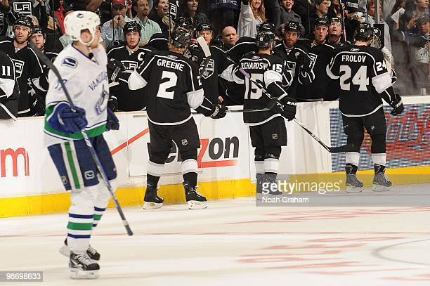 Matt Greene Brad Richardson and Alexander Frolov of the Los Angeles Kings celebrate with the bench after a goal against the Vancouver Canucks in Game...