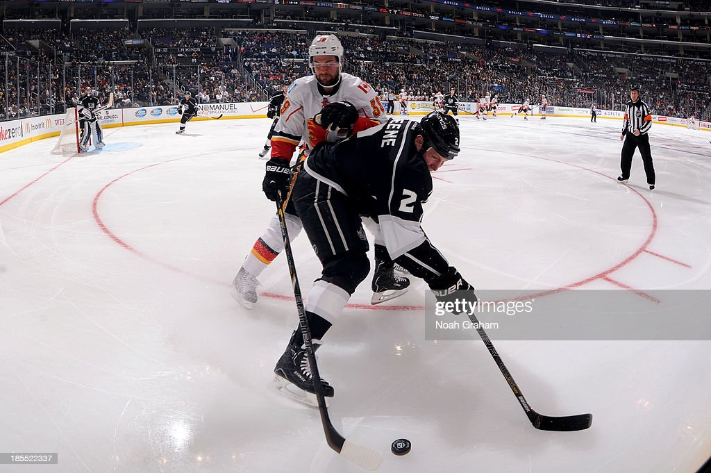 <a gi-track='captionPersonalityLinkClicked' href=/galleries/search?phrase=Matt+Greene&family=editorial&specificpeople=536126 ng-click='$event.stopPropagation()'>Matt Greene</a> #2 of the Los Angeles Kings battles for the puck against TJ Galiardi # 39 of the Calgary Flames at Staples Center on October 21, 2013 in Los Angeles, California.