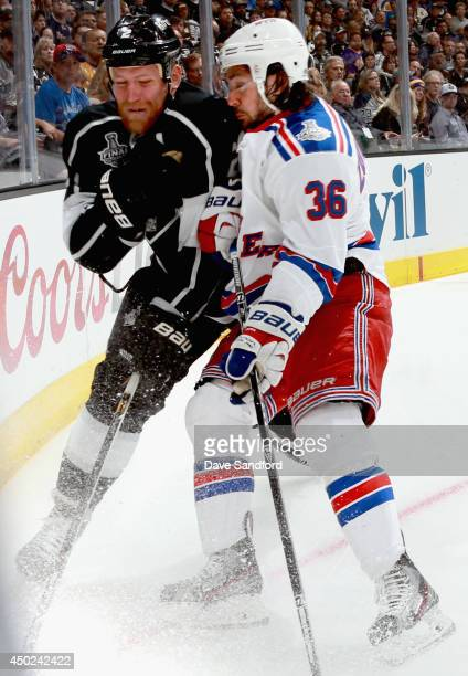 Matt Greene of the Los Angeles Kings collides with Mats Zuccarello of the New York Rangers during the first period of Game Two of the 2014 Stanley...