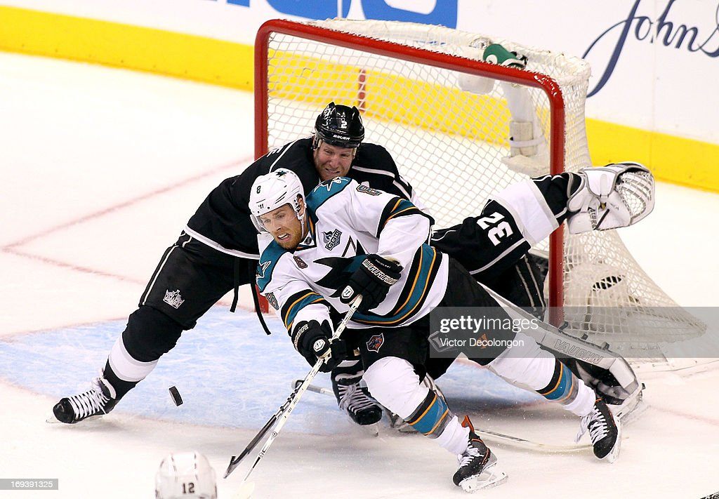 <a gi-track='captionPersonalityLinkClicked' href=/galleries/search?phrase=Matt+Greene&family=editorial&specificpeople=536126 ng-click='$event.stopPropagation()'>Matt Greene</a> #2 of the Los Angeles Kings defends the play of <a gi-track='captionPersonalityLinkClicked' href=/galleries/search?phrase=Joe+Pavelski&family=editorial&specificpeople=687042 ng-click='$event.stopPropagation()'>Joe Pavelski</a> #8 of the San Jose Sharks near the Kings crease area in the third period of Game Five of the Western Conference Semifinals during the 2013 NHL Stanley Cup Playoffs at Staples Center on May 23, 2013 in Los Angeles, California. The Kings defeated the Sharks 3-0.