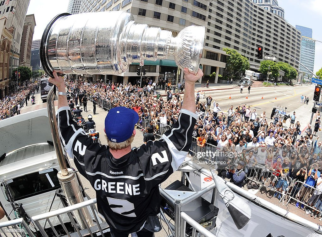 <a gi-track='captionPersonalityLinkClicked' href=/galleries/search?phrase=Matt+Greene&family=editorial&specificpeople=536126 ng-click='$event.stopPropagation()'>Matt Greene</a> #2 of the Los Angeles Kings holds the Stanley Cup during the Los Angeles Kings Parade and Rally on June 14, 2012 at Staples Center in Los Angeles, California.