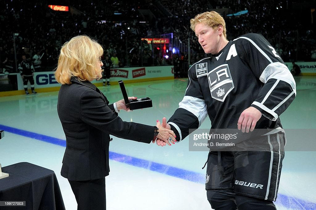 Matt Greene #2 of the Los Angeles Kings receives his 2011-2012 Championship Ring prior to the game against the Chicago Blackhawks at Staples Center on January 19, 2013 in Los Angeles, California.