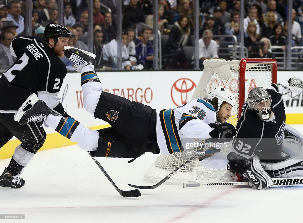 <a gi-track='captionPersonalityLinkClicked' href=/galleries/search?phrase=Matt+Greene&family=editorial&specificpeople=536126 ng-click='$event.stopPropagation()'>Matt Greene</a> #2 of the Los Angeles Kings trips <a gi-track='captionPersonalityLinkClicked' href=/galleries/search?phrase=Bracken+Kearns&family=editorial&specificpeople=3933357 ng-click='$event.stopPropagation()'>Bracken Kearns</a> #38 of the San Jose Sharks up, as goaltender <a gi-track='captionPersonalityLinkClicked' href=/galleries/search?phrase=Jonathan+Quick&family=editorial&specificpeople=2271852 ng-click='$event.stopPropagation()'>Jonathan Quick</a> #32 of the Los Angeles Kings defends in the third period of Game Seven of the Western Conference Semifinals during the 2013 NHL Stanley Cup Playoffs at Staples Center on May 28, 2013 in Los Angeles, California. The Kings defeated the Sharks 2-1.