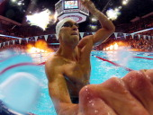Matt Grevers celebrates after he won the championship final of the Men's 100 m Backstroke during Day Three of the 2012 US Olympic Swimming Team...