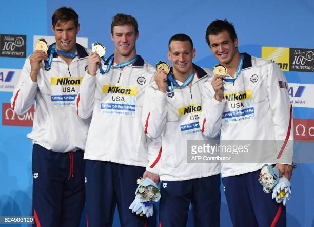 US Matt Grevers US Kevin Cordes US Caeleb Remel Dressel and US Nathan Adrian celebrate on the podium after the final of the men's 4x100m medley relay...