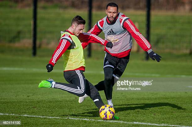 Matt Grimes gets the ball past team mate Kyle Bartley on January 28 2015 in Swansea Wales