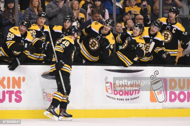 Matt Grzelcyk of the Boston Bruins celebrates his first NHL goal in the second period against the Pittsburgh Penguins at the TD Garden on November 24...