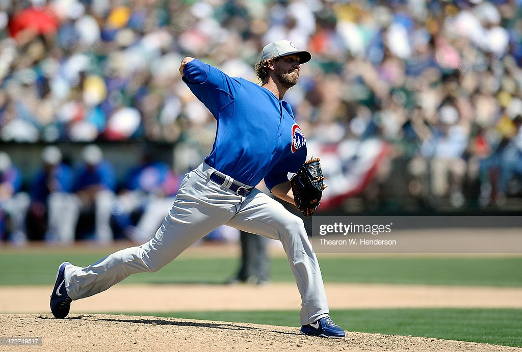 <a gi-track='captionPersonalityLinkClicked' href=/galleries/search?phrase=Matt+Guerrier&family=editorial&specificpeople=575888 ng-click='$event.stopPropagation()'>Matt Guerrier</a> #51 of the Chicago Cubs pitches in the seventh inning against the Oakland Athletics at O.co Coliseum on July 4, 2013 in Oakland, California.