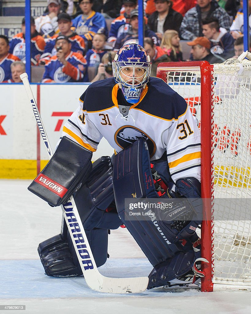 Matt Hackett #31 of the Buffalo Sabres defends the net against the Edmonton Oilers during an NHL game at Rexall Place on March 20, 2014 in Edmonton, Alberta, Canada.