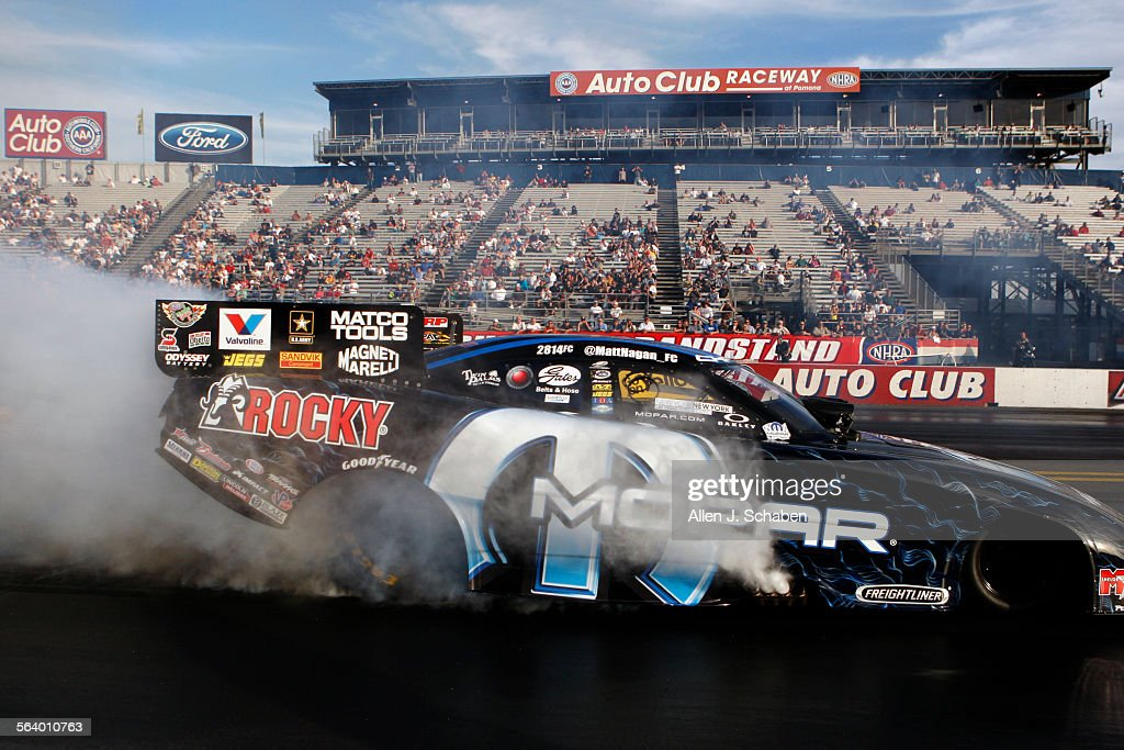 Matt Hagan of Christiansburg VA burns rubber to prepare his tires for a funny car qualifying race in the O'Reilly Auto Parts National Hot Rod...