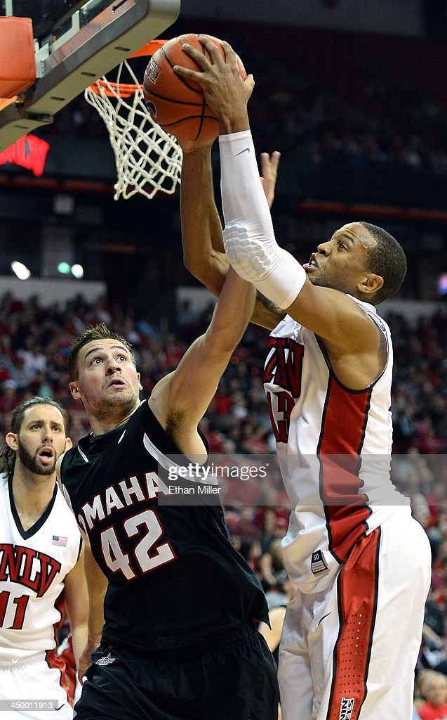 Matt Hagerbaumer #42 of the Nebraska-Omaha Mavericks and Bryce Dejean-Jones #13 of the UNLV Rebels go after a rebound during their game at the Thomas & Mack Center on November 15, 2013 in Las Vegas, Nevada. UNLV won 73-70.