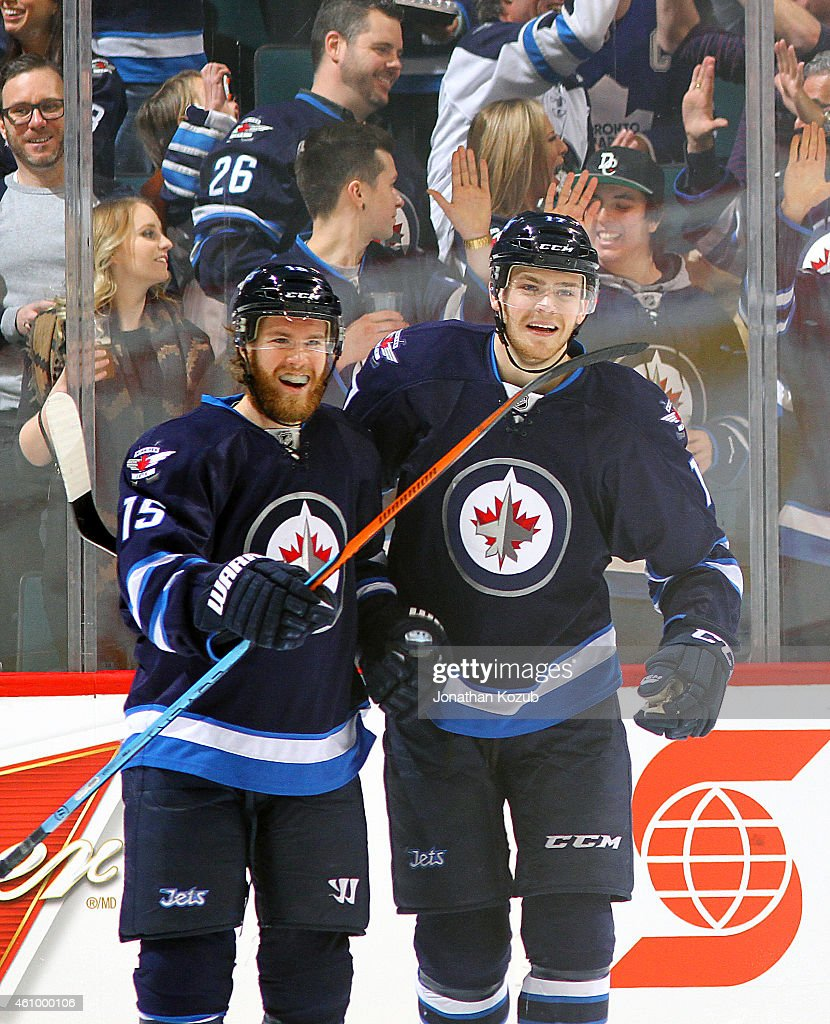Matt Halischuk and Adam Lowry of the Winnipeg Jets celebrate a second period goal against the Toronto Maple Leafs on January 3 2015 at the MTS Centre...