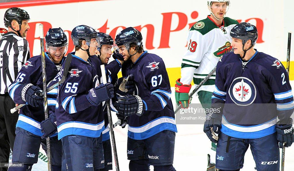 Matt Halischuk Mark Scheifele Grant Clitsome Michael Frolik and Adam Pardy of the Winnipeg Jets celebrate a second period goal against the Minnesota...