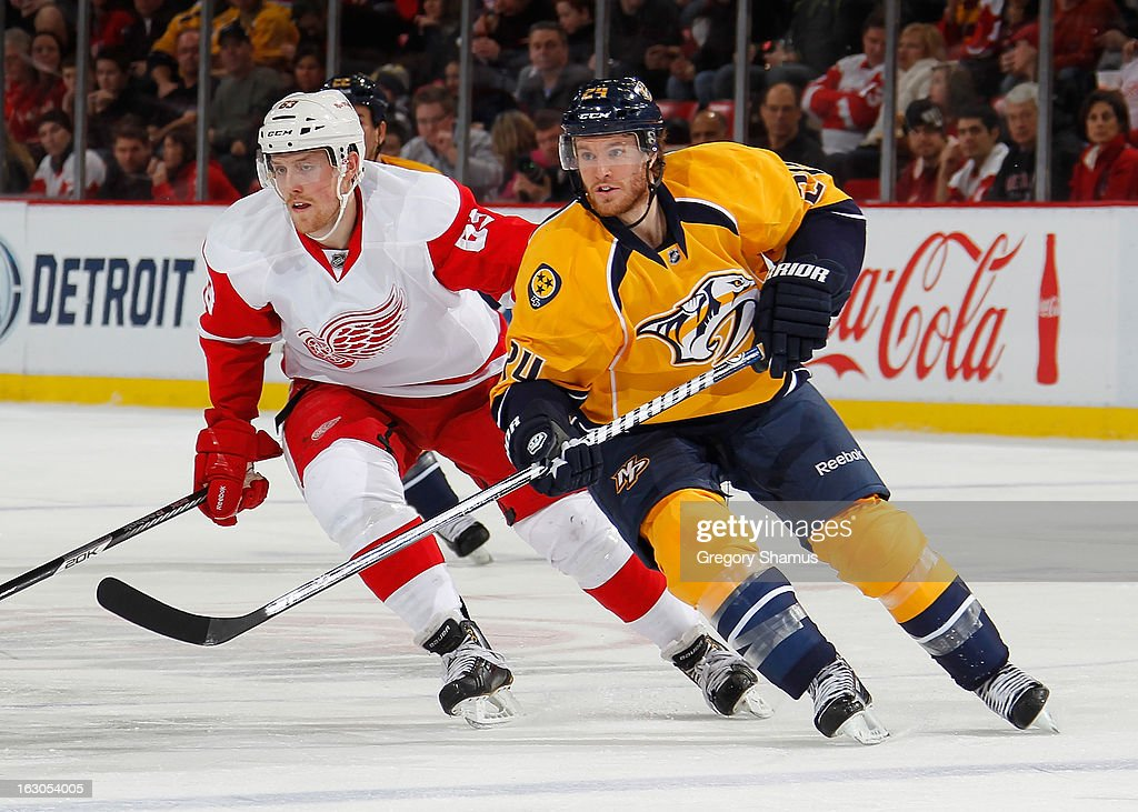Matt Halischuk of the Nashville Predators and Joakim Andersson of the Detroit Red Wings chase the puck at Joe Louis Arena on February 23 2013 in...