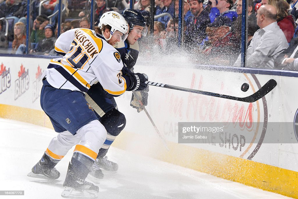 <a gi-track='captionPersonalityLinkClicked' href=/galleries/search?phrase=Matt+Halischuk&family=editorial&specificpeople=714406 ng-click='$event.stopPropagation()'>Matt Halischuk</a> #24 of the Nashville Predators and John Moore #4 of the Columbus Blue Jackets battle for a loose puck during the second period on March 19, 2013 at Nationwide Arena in Columbus, Ohio.