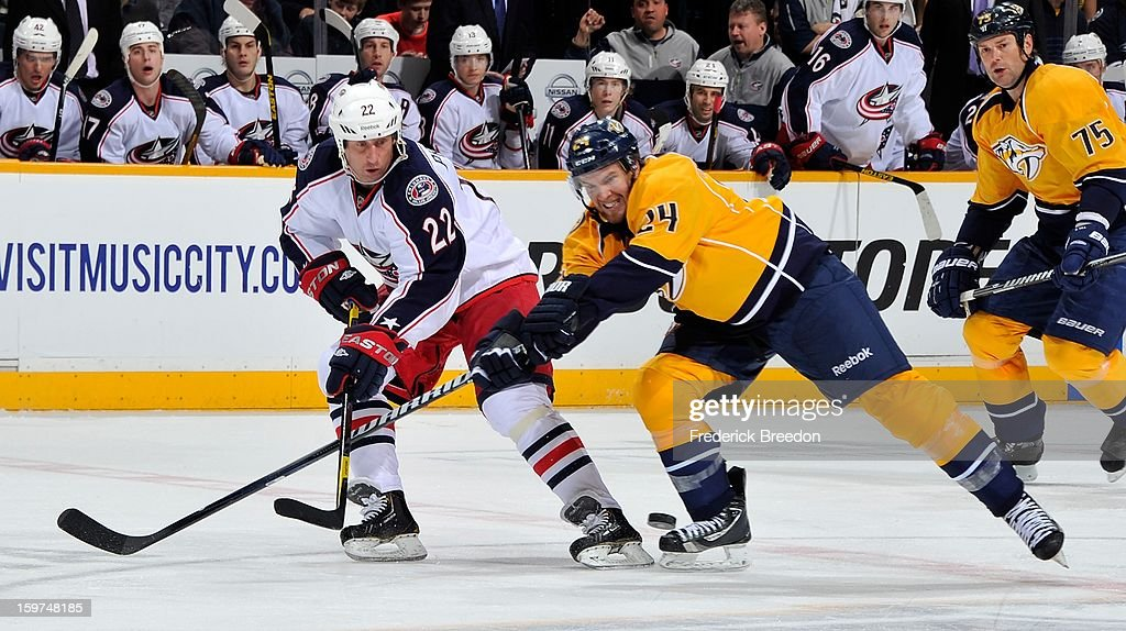 <a gi-track='captionPersonalityLinkClicked' href=/galleries/search?phrase=Matt+Halischuk&family=editorial&specificpeople=714406 ng-click='$event.stopPropagation()'>Matt Halischuk</a> #24 of the Nashville Predators and Vinny Prospal #22 of the Columbus Blue Jackets fight for the puck in the season opener at the Bridgestone Arena on January 19, 2013 in Nashville, Tennessee.