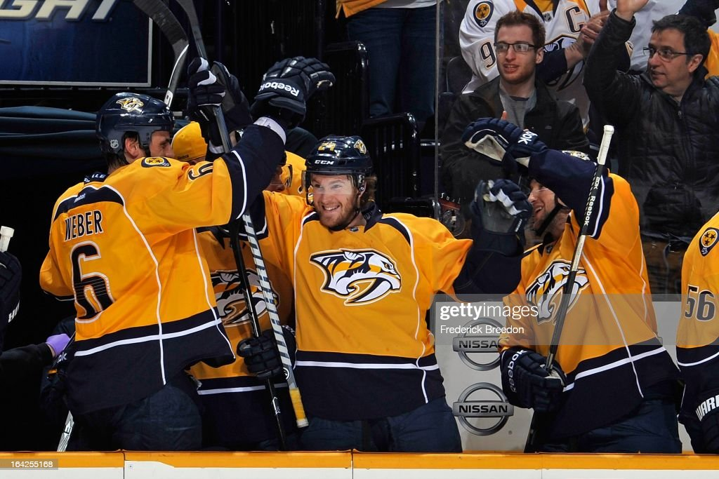 <a gi-track='captionPersonalityLinkClicked' href=/galleries/search?phrase=Matt+Halischuk&family=editorial&specificpeople=714406 ng-click='$event.stopPropagation()'>Matt Halischuk</a> #24 of the Nashville Predators celebrates a Predators goal against the Calgary Flames with teammates <a gi-track='captionPersonalityLinkClicked' href=/galleries/search?phrase=Shea+Weber&family=editorial&specificpeople=554412 ng-click='$event.stopPropagation()'>Shea Weber</a> #6 and <a gi-track='captionPersonalityLinkClicked' href=/galleries/search?phrase=Chris+Mueller+-+Ice+Hockey+Player&family=editorial&specificpeople=575730 ng-click='$event.stopPropagation()'>Chris Mueller</a> #17 at the Bridgestone Arena on March 21, 2013 in Nashville, Tennessee.