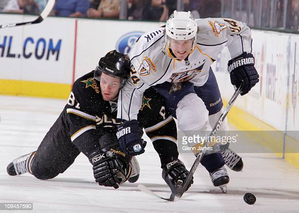 Matt Halischuk of the Nashville Predators tries to keep the puck away against Tomas Vincour of the Dallas Stars at the American Airlines Center on...