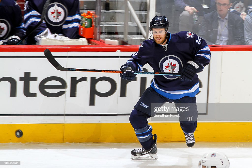 Matt Halischuk of the Winnipeg Jets chases after the loose puck during third period action against the Colorado Avalanche on October 26 2014 at the...