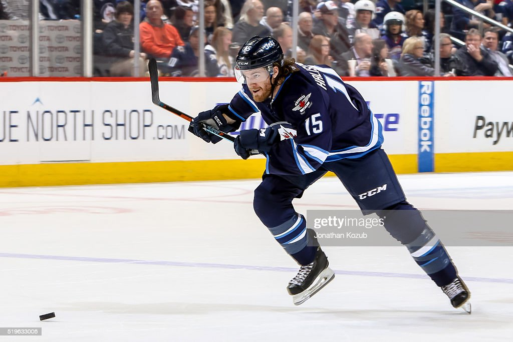 Matt Halischuk of the Winnipeg Jets chases the puck down the ice during second period action against the Chicago Blackhawks at the MTS Centre on...