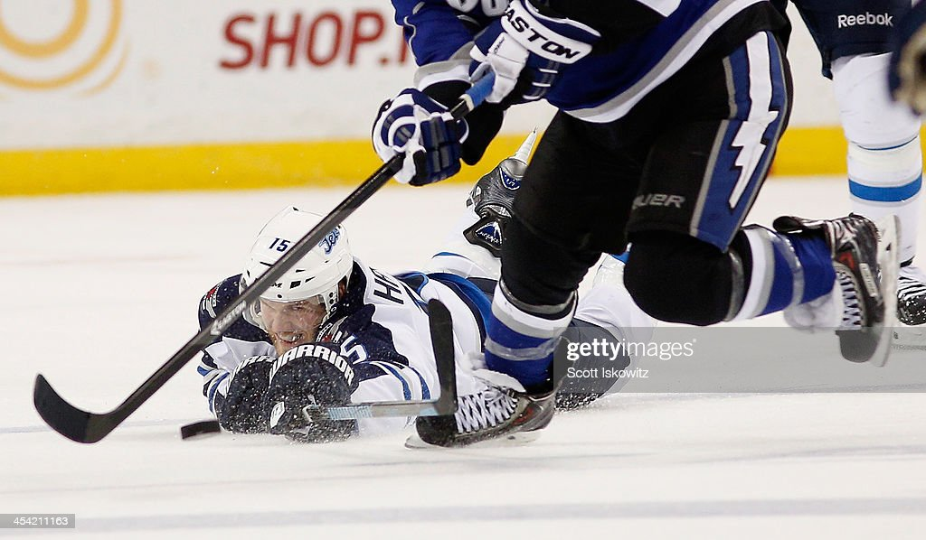 Matt Halischuk of the Winnipeg Jets dives to reach the puck against Tyler Johnson of the Tampa Bay Lightning during the second period at Tampa Bay...