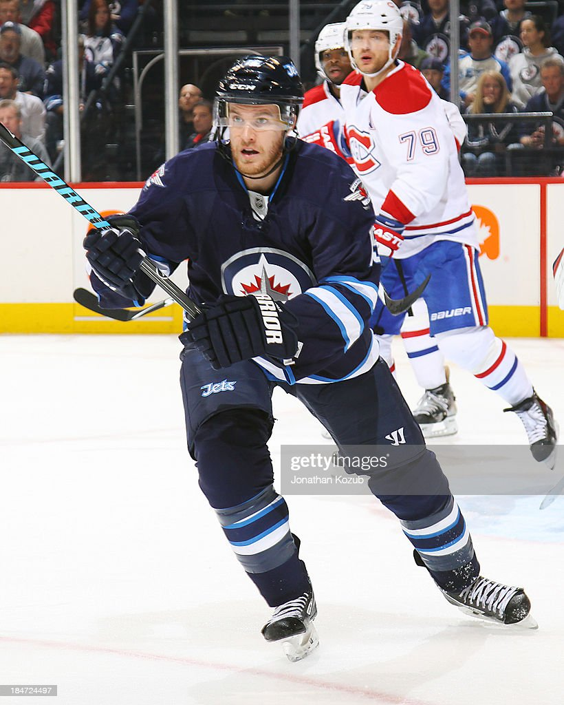 <a gi-track='captionPersonalityLinkClicked' href=/galleries/search?phrase=Matt+Halischuk&family=editorial&specificpeople=714406 ng-click='$event.stopPropagation()'>Matt Halischuk</a> #15 of the Winnipeg Jets follows the play during third period action against the Montreal Canadiens at the MTS Centre on October 15, 2013 in Winnipeg, Manitoba, Canada.