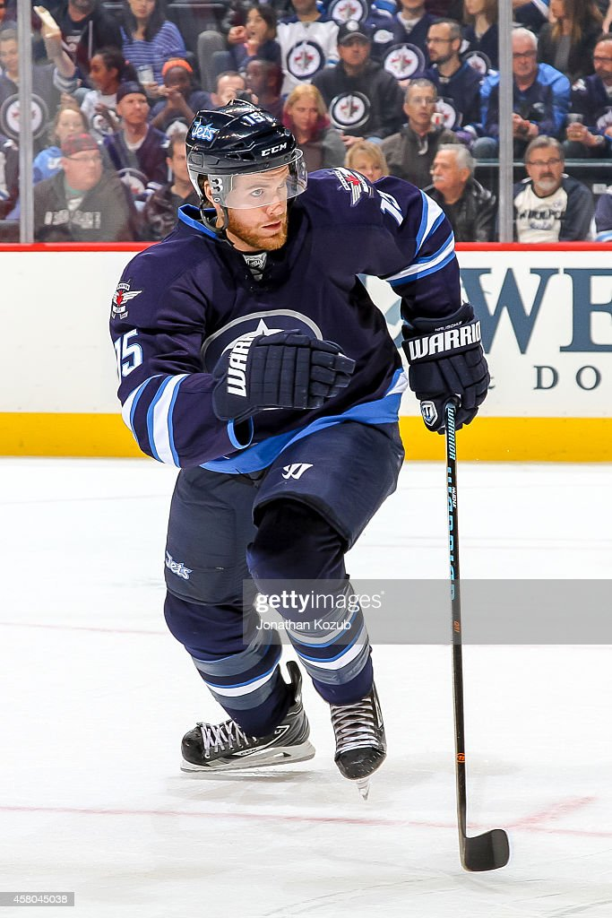 Matt Halischuk of the Winnipeg Jets follows the play up the ice during third period action against the Carolina Hurricanes on October 21 2014 at the...
