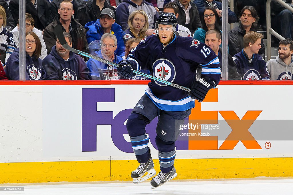 Matt Halischuk of the Winnipeg Jets follows the play up the ice during first period action against the New York Islanders at the MTS Centre on March...