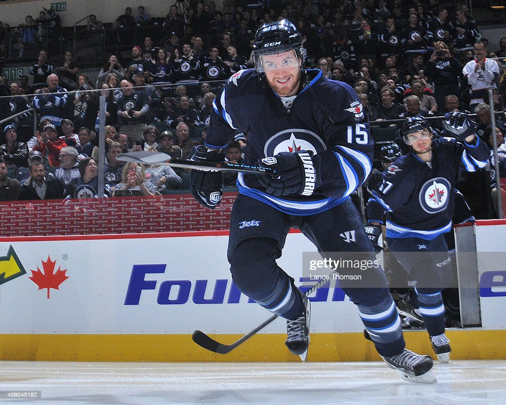 Matt Halischuk of the Winnipeg Jets hits the ice prior to puck drop against the Carolina Hurricanes on October 21 2014 at the MTS Centre in Winnipeg...